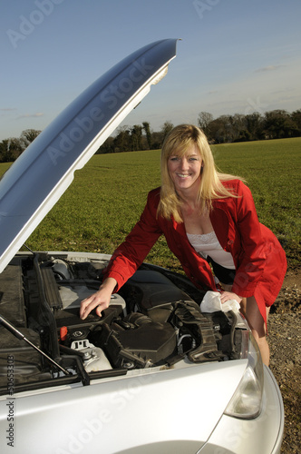 female motorist with car bonnet raised