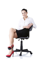 Businesswoman sitting on ofice chair