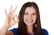 Happy teen girl gesturing perfect
