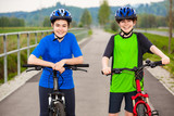 Girl and boy biking