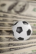 Soccer ball on background of dollars