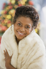 African woman wearing fur coat
