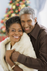 African couple hugging on Christmas