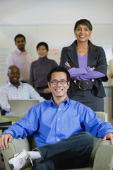 Multi-ethnic business people posing in office