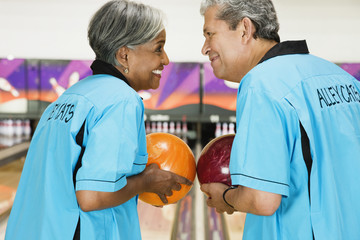 Two friends on bowling league about to bowl