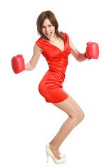 Woman in red, wearing boxing gloves, isolated on white