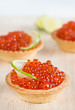 Tartlets with red caviar and lime