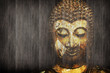 Ancient Buddha face on wood background