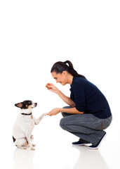 woman giving her pet dog food