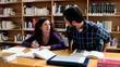 Man annoying woman while studing