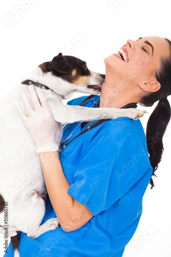 pet dog licking vet nurse's neck