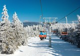 chair lift on mountain for downhill skiers