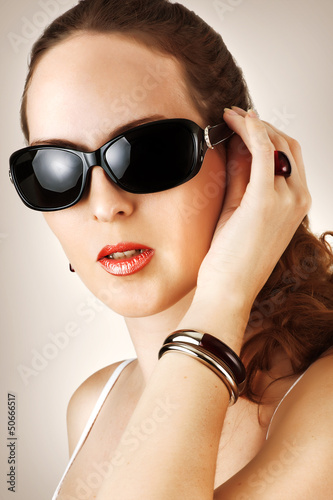 Young woman with fahion black glasses