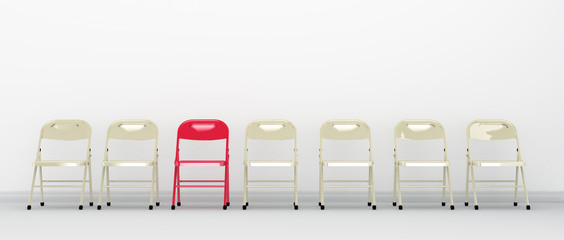 Standing out among others. Red chair standing out