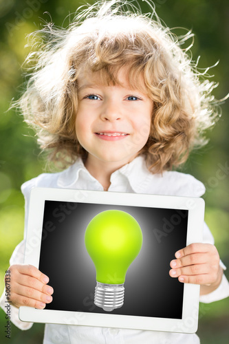 Child holding tablet PC with lightbulb