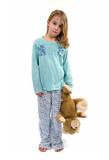 Tired girl in pajamas holding teddybear