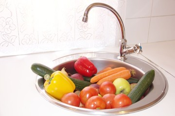 Clean vegetables in a sink