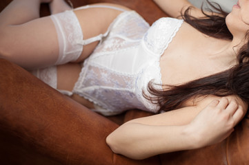 Sensual bride lying on a sofa
