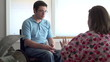 Man in wheelchair at home with nurse