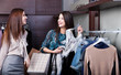 Two girlfriends are joking while do shopping at the store