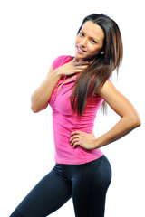 Smiling happy female fitness model looking at camera