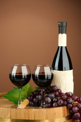 Composition of wine bottle, glasses and  grape,on wooden