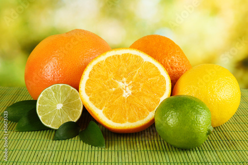 Fruits with leafs on table on bright background