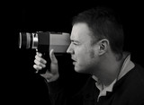 profile view of man with cine film / video camera