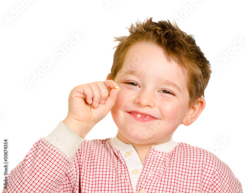 Child showing off his lost tooth isolated on white