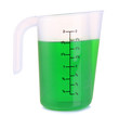 Measuring cup with green liquid isolated on white