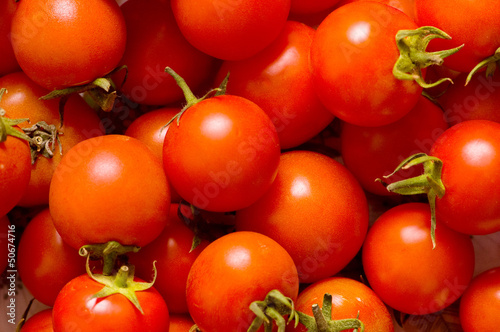 Many red tomatoes arranged at the market