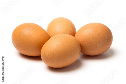 Four eggs with shadows isolated on white background