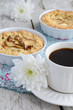 Breakfast with coffee, apple tart and white flowers