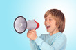 Portrait of adorable child with a megaphone