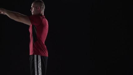 Man does backflip in slow motion, black background