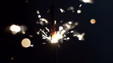 a sparkler being ignited making abstract pattern in slow motion