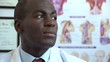 African American doctor turning and looking at camera