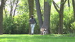 African American man walking his dog at the park