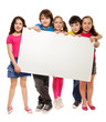 Group of schoolchildren holding white board