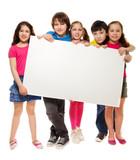 Group of schoolchildren holding white board poster