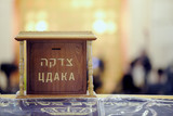 Wooden tzedakah in synagogue