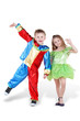 Little boy and girl in carnival suits stand, holding hands