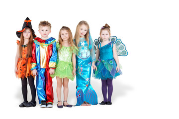 Children in carnival costumes  stand in line with serious faces