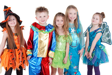 Smiling children in carnival costumes  stand in line