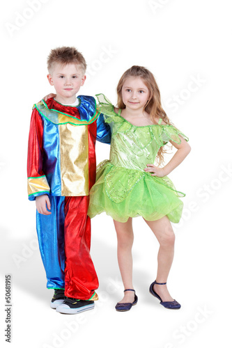 Little boy and girl in carnival suits stand, slightly embracing