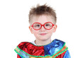 Cute little boy in big red glasses and clown costume isolated