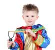 Little boy in clown costume holds slingshot and looks at camera