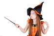 Little girl in orange costume of witch for Halloween holds wand