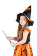 Girl in orange costume of witch for Halloween holds wand