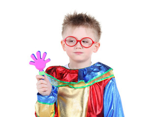 Little boy in big red glasses and clown costume holds toy hand